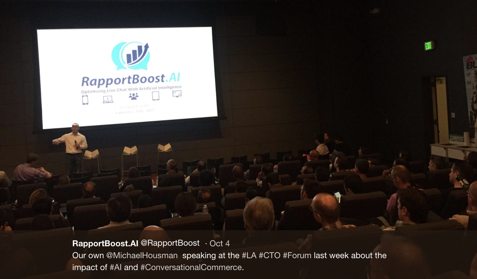 An image of Michael Housman of RapportBoost.AI presenting at a recent conference.