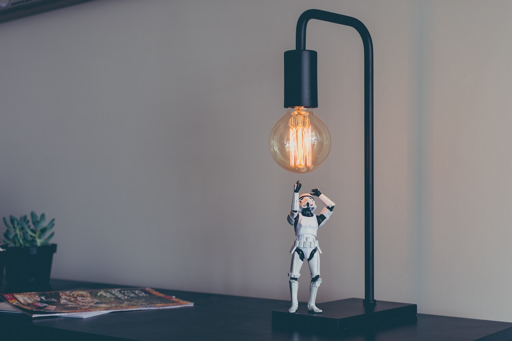 """An image of a Storm Trooper figurine and a light. Artificial intelligence - """"chatbots"""" - can help shed light on customer sentiment."""