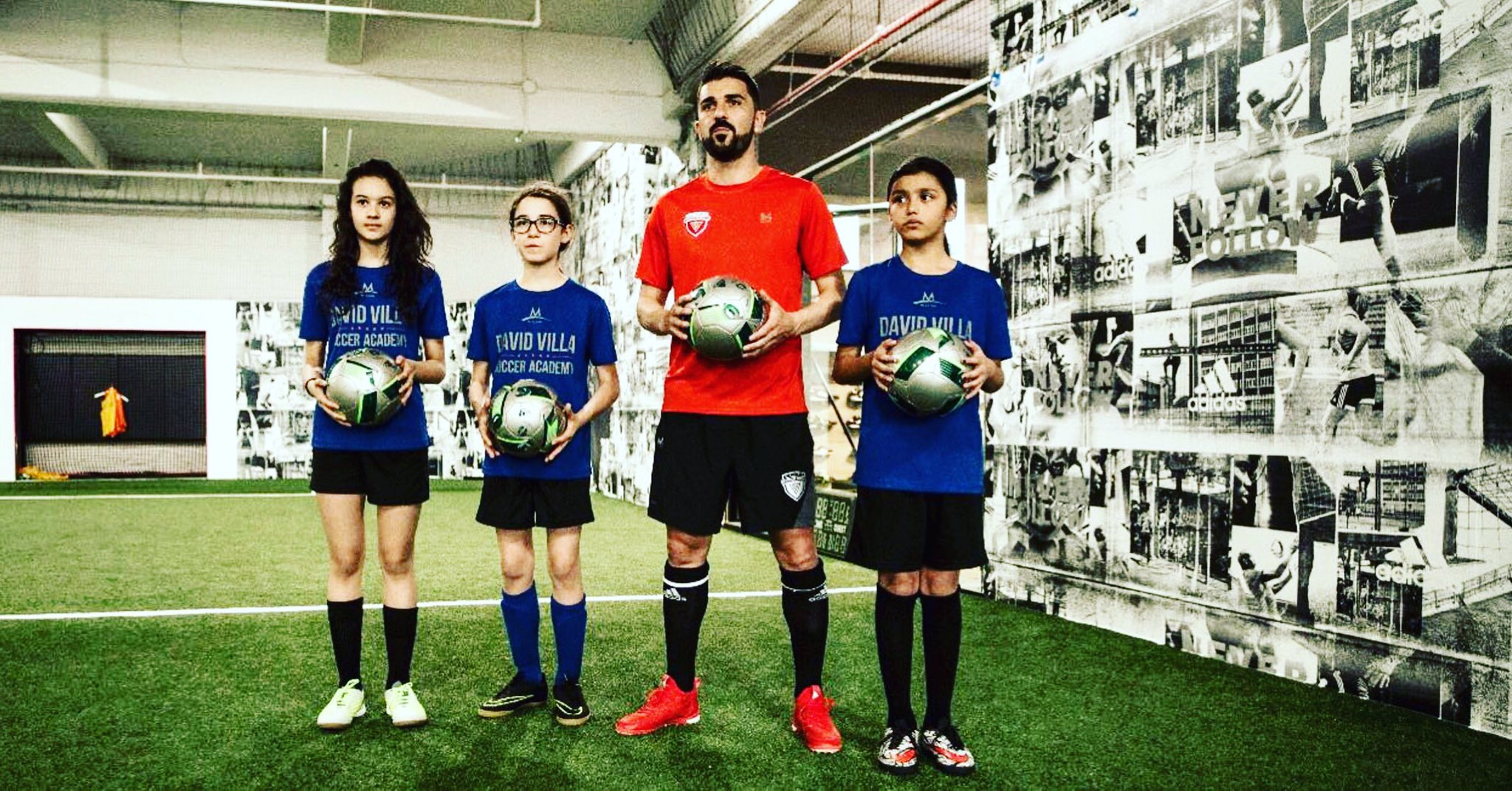 A picture of David Villa and youth soccer players at an Upper 90 Soccer Store. Ben Jata is the Director of Operations for Upper 90 and uses Olark live chat software on the website.
