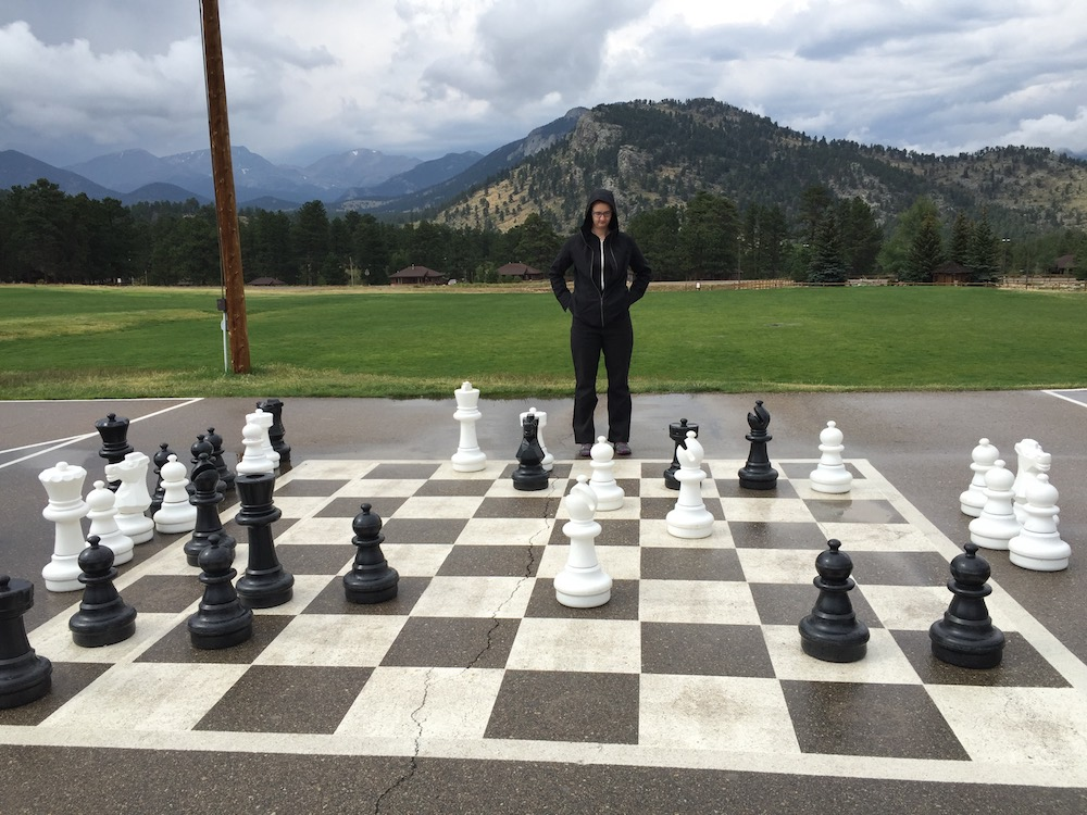 An image of a person looking at an oversize chess board. When faced with a lot of sales leads, it can be difficult to tell which is the best path forward.